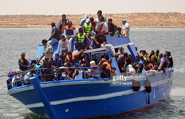 Migrants arrive at the port in the Tunisian town of Ben Guerdane some 40 kilometres west of the Libyan border following their rescue by Tunisia's...