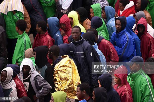 Migrants arrive at the Temporary Permanence Centre on February 19 2015 in Lampedusa Italy Hundreds of migrants have recently arrived in Lampedusa...