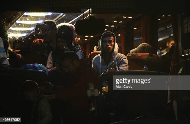 Migrants arrive by coach from Athens at a refugee transit camp that has been set up besides the border with Greece and the Former Yugoslav Republic...
