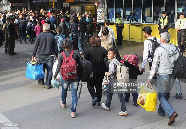 Migrants arrive from Austria at Munich Hauptbahnhof main railway station on September 5 2015 in Munich Germany Thousands of migrants are traveling to...