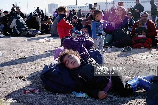 Migrants arrive in Pireaus port of Athens from several Greek islands on February 22 2016 in Athens Greece Several thousand migrants have been...