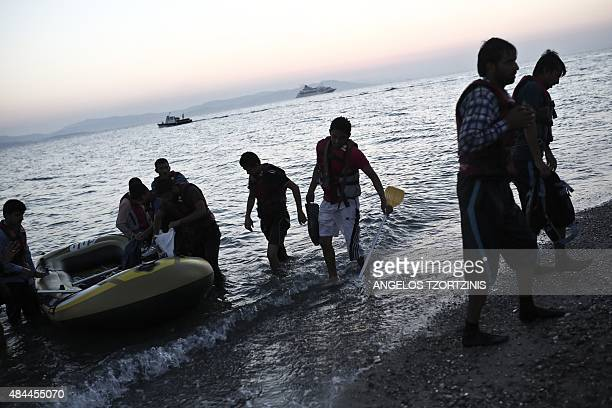 Migrants arrive on the shore of Kos island after crossing from Turkey on a small dinghy on August 19 2015 The UN refugee agency said in the last week...