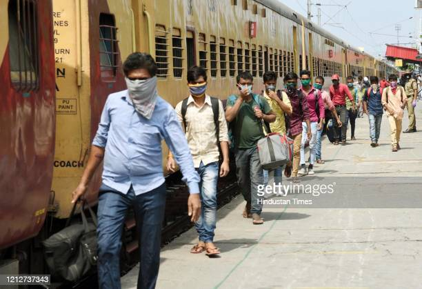 Migrants arriving from Tamil Nadu and Andhra Pradesh by a special train, seen at Danapur Railway Station, on May 11, 2020 in Patna, India.