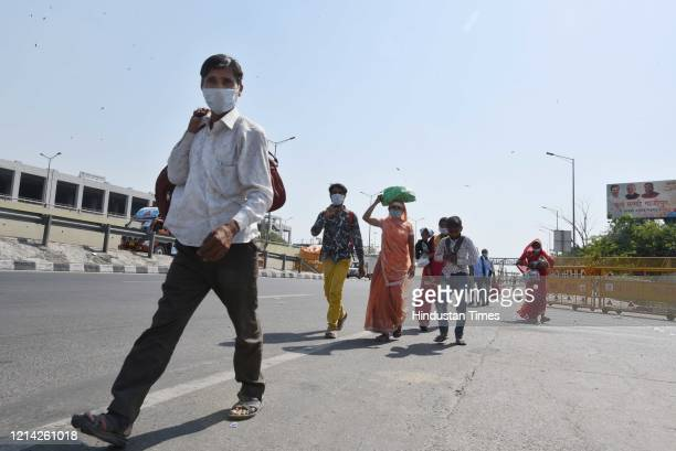 Migrants at Ghazipur border after being stopped by Uttar Pradesh Police from entering the state on foot on May 20, 2020 in New Delhi, India.