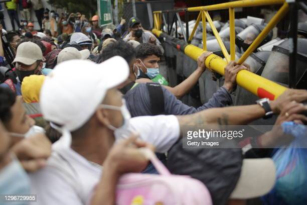 Migrants attempt to break a police barricade to enter Guatemala at the border checkpoint on January 16, 2021 in El Florido, Guatemala. The caravan...