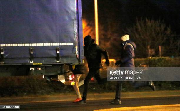 Migrants attempt to enter a truck near the port of Ouistreham northwestern France late February 27 2018 More than a year after the dismantling of the...
