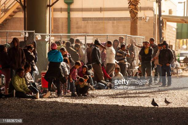 Migrants awaiting processing are held in temporary fencing underneath the Paso Del Norte Bridge on March 28 2019 in El Paso Texas US Customs and...