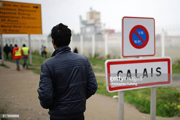 Migrants begin to leave the Jungle camp before authorities demolish the site on October 24 2016 in Calais France Police and officials in France are...
