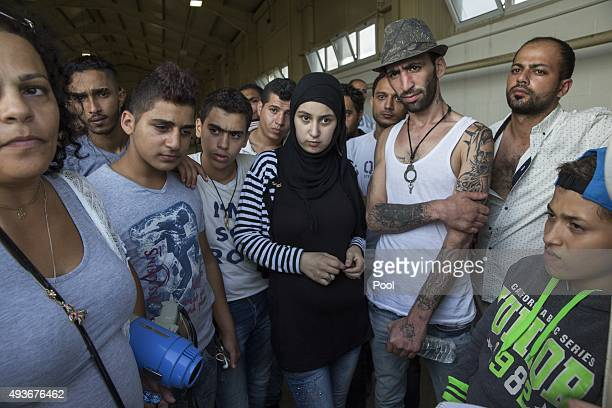 Migrants believed to be Syrian are temporarily housed at a warehouse at RAF Akrotiri on October 21 2015 in Akrotiri Cyprus Two boats carrying over...