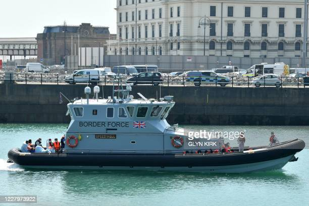 Migrants , believed to have been picked up from boats in the Channel by UK Border Force officers, arrive in the harbour aboard Coastal patrol vessel...
