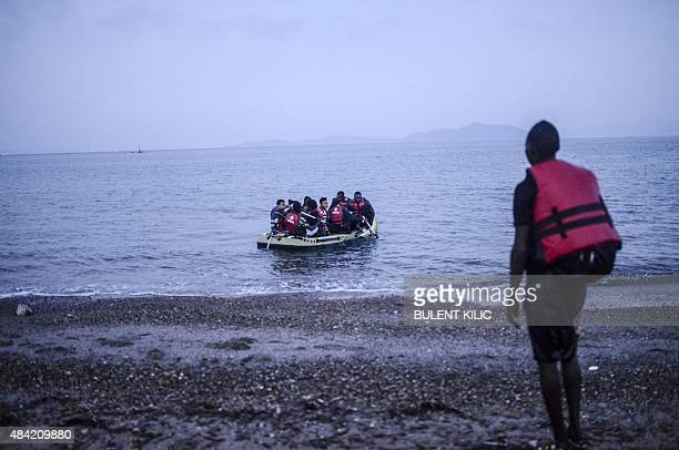 Migrants board a boat to the Greek island of Kos on early August 16 2015 off the shore of Bodrum southwest Turkey Authorities on the island of Kos...