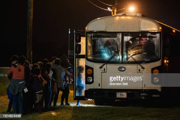 Migrants board a bus to be taken to a border patrol processing facility after crossing the Rio Grande into the U.S. On June 21, 2021 in La Joya,...