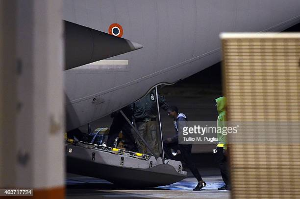 Migrants board a plane at Lampedusa airport bound for a detention center elsewhere in the country on February 17 2015 in Lampedusa Italy Hundreds of...