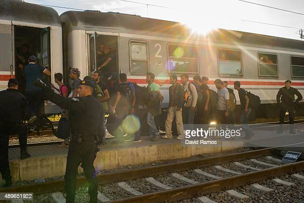 Migrants board a train heading for Zagred at Tovarnik station as more migrants arrive from the Serbian border on September 23 2015 in Tovarnik...