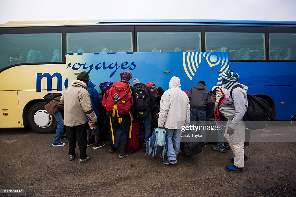Migrants Leave The Jungle Refugee Camp In Calais : News Photo