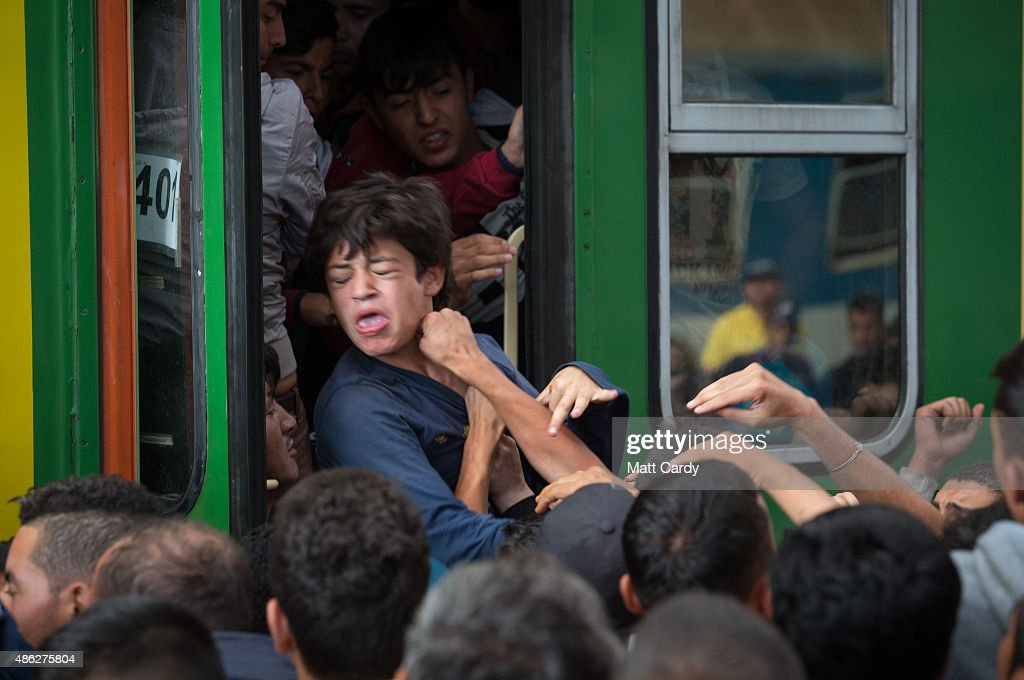Migrants board trains in Keleti station after it was reopened this morning in central Budapest on September 3, 2015 in Budapest, Hungary. Although the station has reopened all international trains to Western Europe have been cancelled. According to the Hungarian authorities a record number of migrants from many parts of the Middle East, Africa and Asia are crossing the border from Serbia. Since the beginning of 2015 the number of migrants using the so-called Balkans route has exploded with migrants arriving in Greece from Turkey and then travelling on through Macedonia and Serbia before entering the EU via Hungary. The massive increase, said to be the largest migration of people since World War II, led Hungarian Prime Minister Victor Orban to order Hungary's army to build a steel and barbed wire security barrier along its entire border with Serbia, after more than 100,000 asylum seekers from a variety of countries and war zones entered the country so far this year.