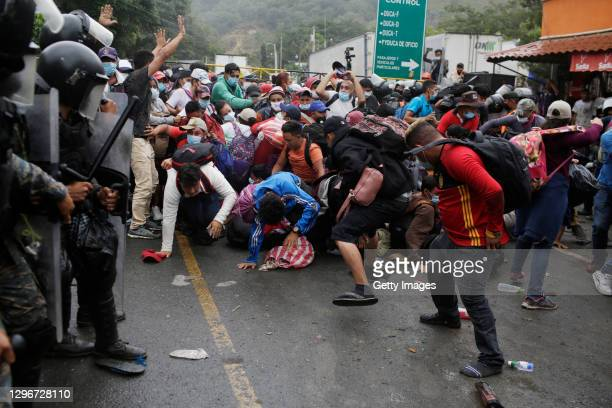 Migrants break a police barricade as they attempt to enter Guatemala at the border checkpoint on January 16, 2021 in El Florido, Guatemala. The...