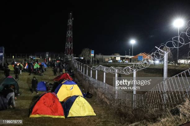 Migrants camp in tents next to the border fence at the Serbian Kelebija border village near Subotica on February 6 as the Tompa road border-crossing...