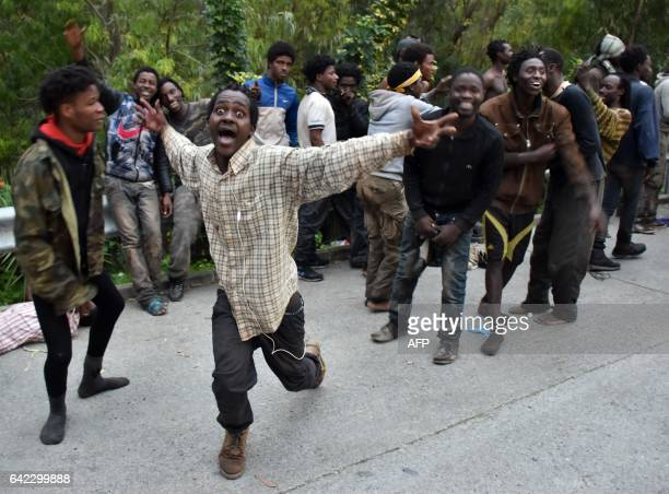 TOPSHOT Migrants celebrate outside the Center for Temporary Stay of Immigrants after forcing their way through a fence between Morocco and the tiny...