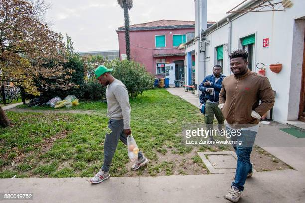 Migrants come back from the supermarket with shopping bags in the 'CAS' center at the Caracol cooperative on November 27 2017 in Venice Italy The...