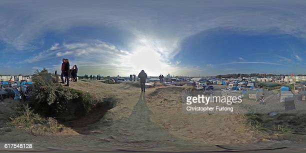 Migrants contemplate their next move as a the planned demolition of the the Jungle migrant camp nears on October 23 2016 in Calais France Volunteers...