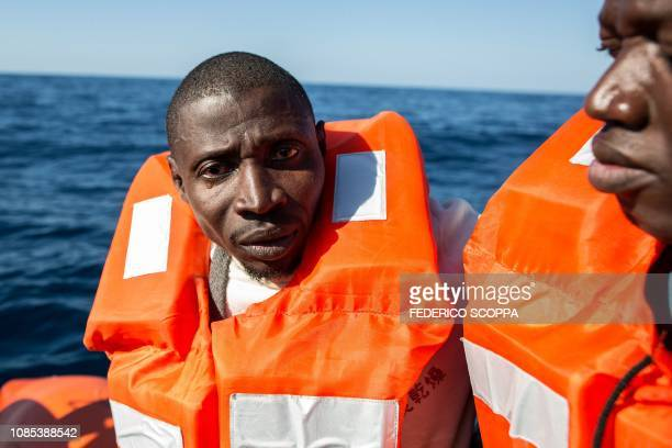 A migrants cries while being transfered from a rescued unflatable boat onto the Dutchflagged vessel Sea Watch 3 during a rescue operation off Libya's...