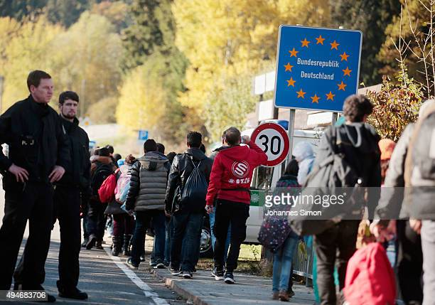 Migrants cross border to Austria on October 28, 2015 near Wegscheid, Germany. Bavarian Governor Horst Seehofer has accused the Austrian government of...
