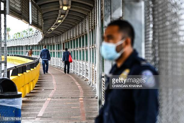 Migrants cross the border at the Gateway International Bridge into the Mexico from Brownsville, Texas, to Matamoros, Mexico on March 15, 2021. - It's...