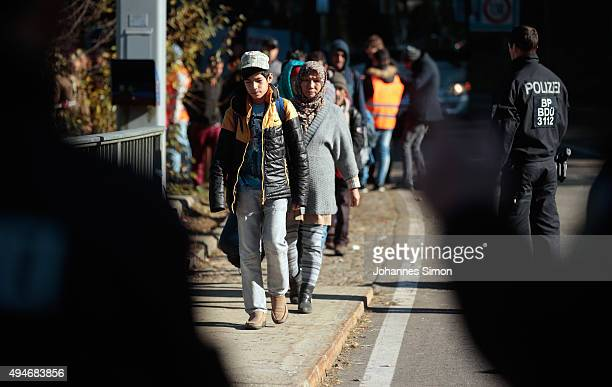 Migrants cross the German border to Austria on October 28, 2015 near Wegscheid, Germany. Bavarian Governor Horst Seehofer has accused the Austrian...