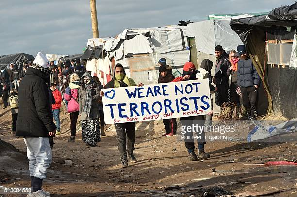 TOPSHOT Migrants demonstrate on February 29 during the dismantling of half of the 'Jungle' migrant camp in the French northern port city of Calais...