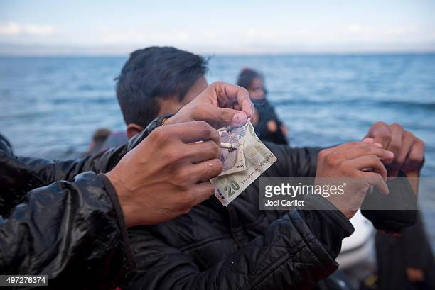 migrants destroying turkish currency after boat journey - human trafficking stock photos and pictures