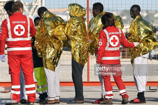 Migrants disembark from the German NGO Sea Watch3 ship on November 8 2017 in the Sicilian harbour of Pozzallo During a shipwreck five people died...