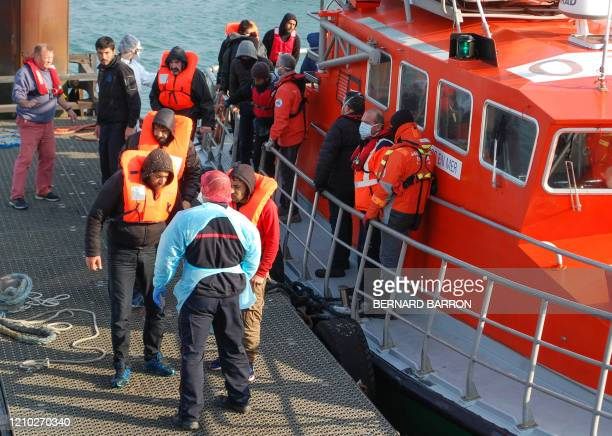Migrants disembark from the SNSM Calais life boat on April 17 after being rescued off the coast of Calais trying to cross to Great Britain during the...