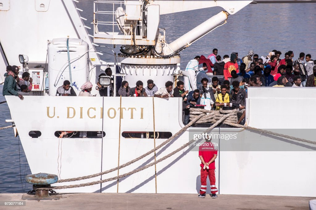 Migrants disembark the Italy's coastguard ship Diciotti at the port of Catania on June 13, 2018 in Catania, Italy. The Diciotti ship carried 932 migrants rescued in Mediterranean Sea in the last days, and two bodies. Among the rescued people there were children and 13 pregnant women. The Italian interior Minister, Matteo Salvini said on Sunday that all Italian ports were closed to the rescue boat Aquarius chartered by Sos Mediterranee.