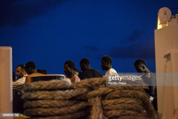 Migrants disembarked from a Coast Guard ship as it arrived at the port carrying 1004 African migrants