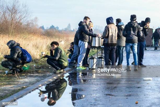 Migrants drink tea After the destruction of jungle camp in October 2016 migrants in Calais have been receiving food from volunteer associations Since...