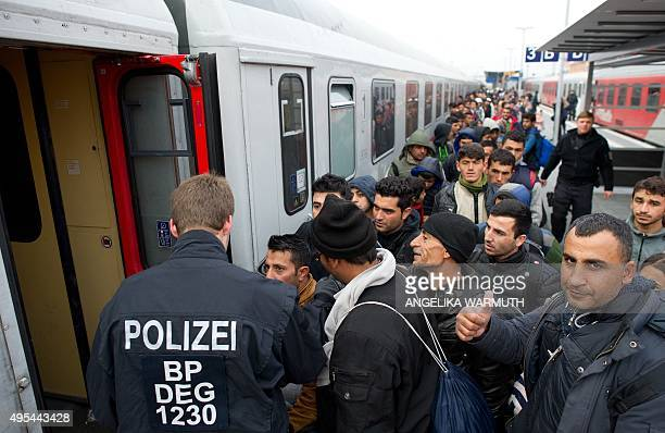 Migrants enter a special train to bring them to Duesseldof western Germany on a platform of the railway station in Passau southern Germany on...