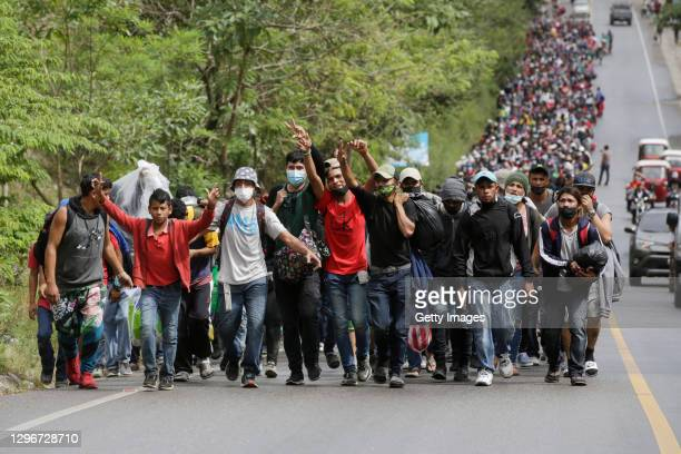 Migrants enter Guatemala after breaking a police barricade at the border checkpoint on January 16, 2021 in El Florido, Guatemala. The caravan...