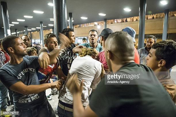 Migrants fight each other outside the main Eastern Railway station in Budapest Hungary September 1 2015 Hundreds of angry migrants demonstrated on...