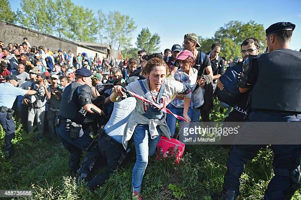 Migrants force their way through police lines at Tovarnik station to board a train bound for Zagreb on September 17, 2015 in Tovarnik, Croatia....