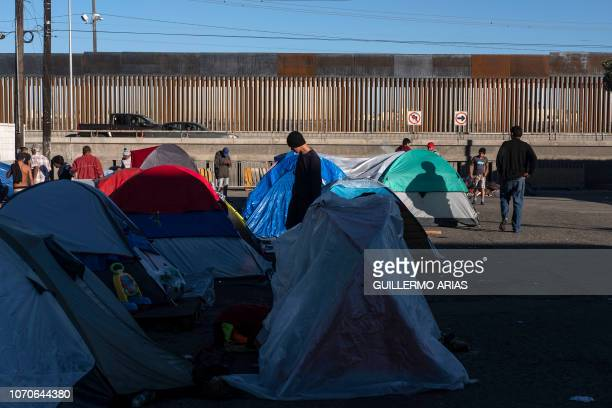 Migrants forming part of the Central American caravan traveling to the US stay in a camp on the street near the USMexico border in Tijuana Baja...