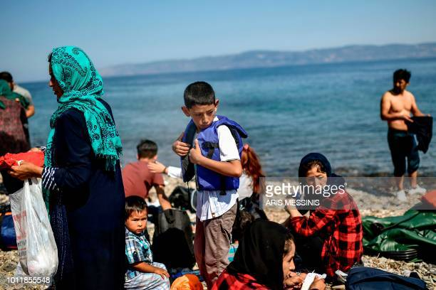 Migrants from Afghanistan arrive after crossing the Aegean Sea from Turkey with a dinghy on the Greek Mediterranean island of Lesbos on August 6 2018...