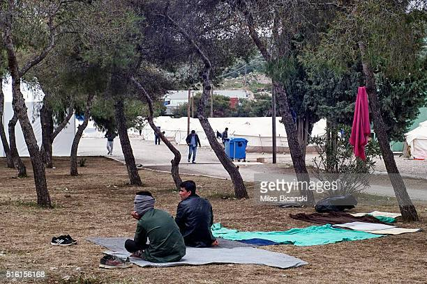 Migrants from Afghanistan pray at a refugee camp in the western Athens' suburb of Schisto on March 17 2016 in Athens Greece The decision by Macedonia...