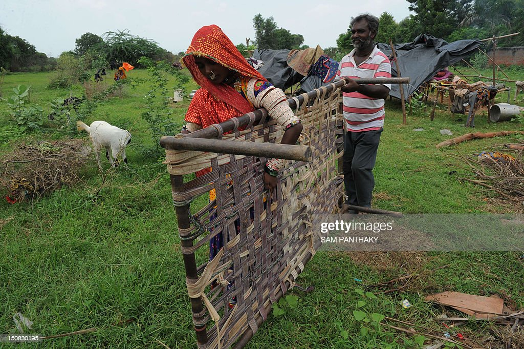 Migrants from Banas Kantha region of India's Gujarat state lift a
