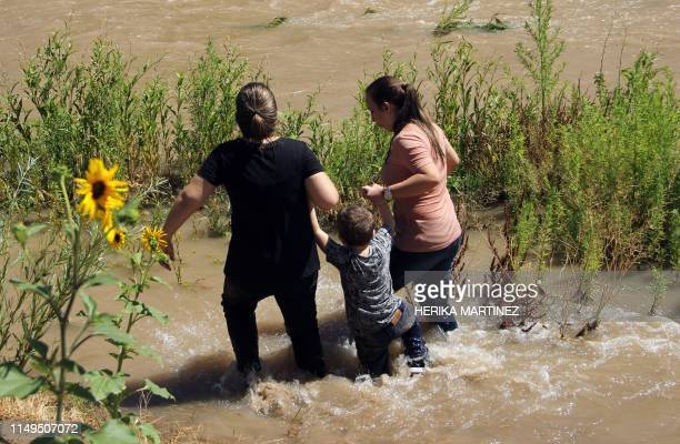 Migrants from Brazil cross the Rio Grande in Ciudad Juarez, State of Chihuahua, Mexico, on June 12 before turning themselves into US Border Patrol...