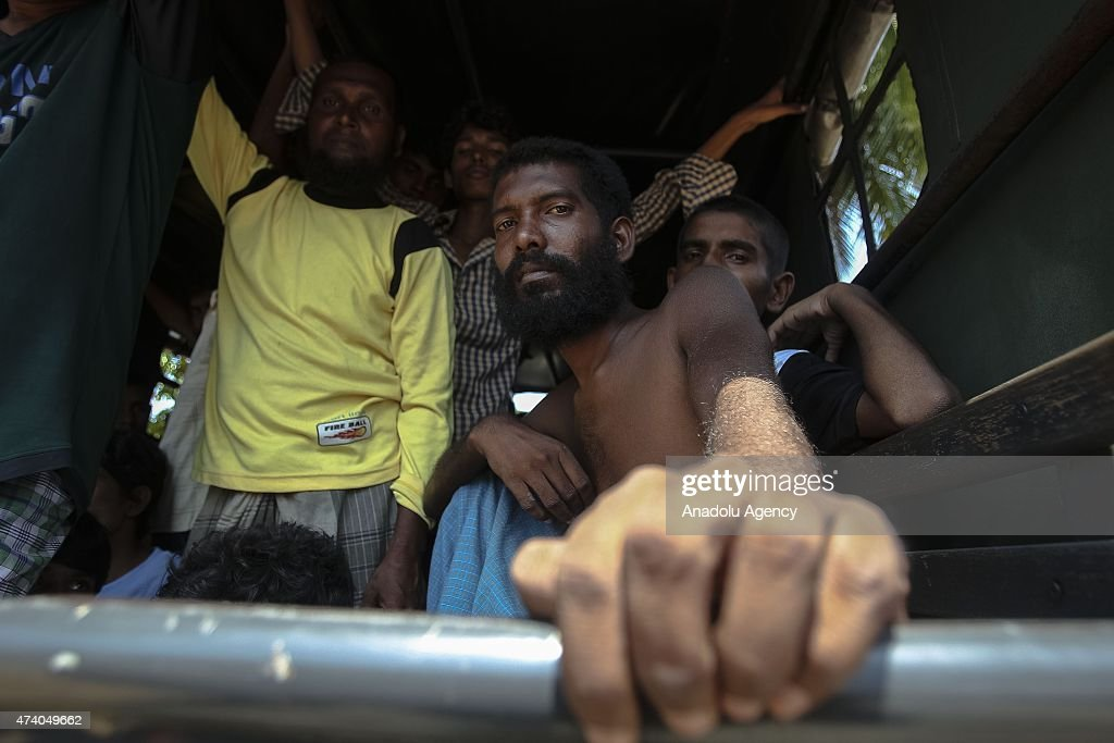 Migrants from Myanmar and Bangladesh are rescued by Aceh fishermen in Idi Rayeuk town of Aceh province, Indonesia, and carried to Kuala Langsa to be placed at the temporary shelters on May 20, 2015. Indonesian fishermen rescued more than 400 migrants, many from Myanmar's Rohingya minority, a rescue official said.