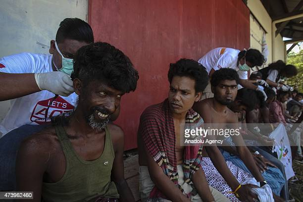Migrants from Myanmar have their hair cut at the camp shelters in the fishing port of Kuala Langsa in Aceh province May 19 2015 Hundreds of migrants...
