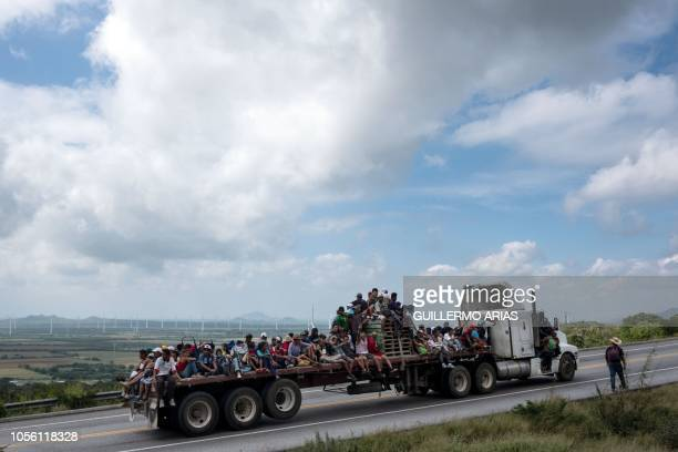 TOPSHOT Migrants from poor Central American countries mostly Hondurans moving towards the United States in hopes of a better life or to escape...