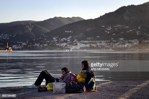Migrants from Syria wait in the port of Mytilene on the Greek island of Lesbos on December 6 2015 Turkish coastguard apprehended in the past week a...