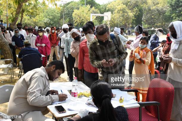Migrants from various states are registered for transport services being provided by the Delhi government at Delhi Pharmaceutical Sciences and...
